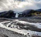 Gigjökull glacier tongue, protruding from the dark, barren landscape.
