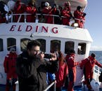 Protective overalls will help keep you warm in winter on a whale watch from Reykajvík.