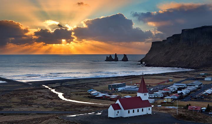 Dawn pouring over Vík on the South Coast of Iceland.