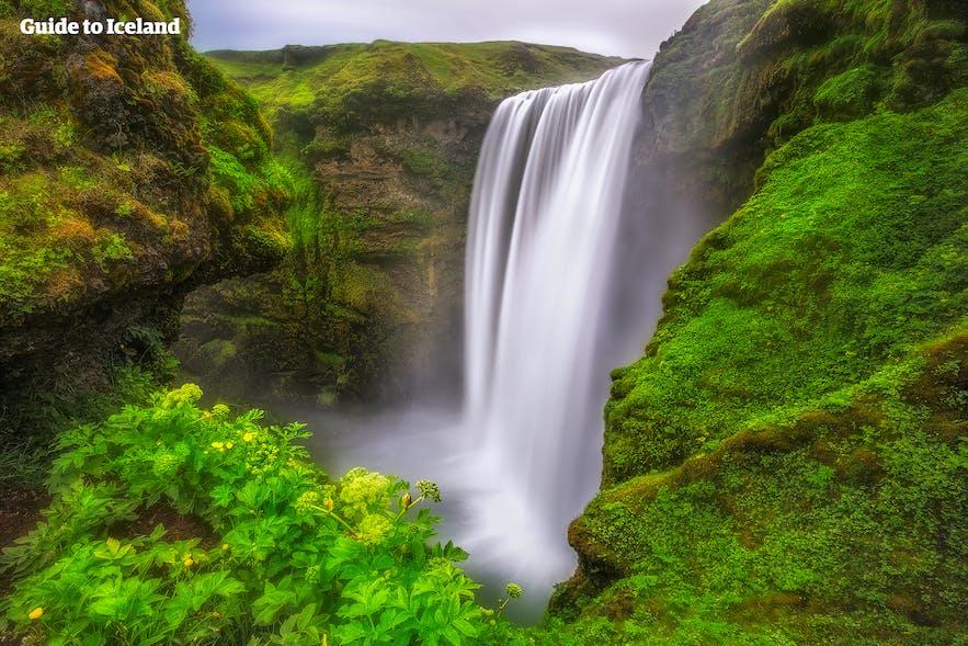 Skógafoss waterfall is between two Icelandic glaciers