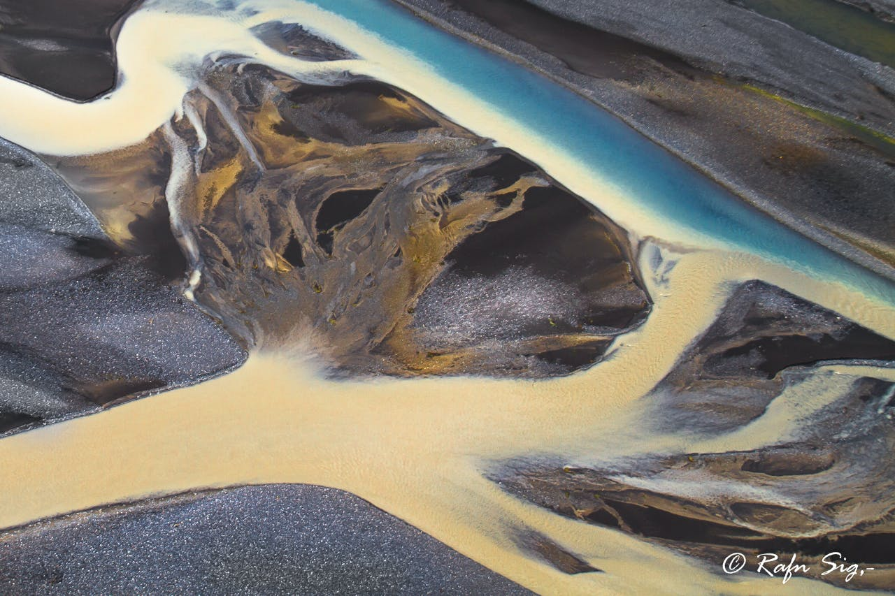 Iceland's delicate river systems appear like paint strokes across a plain canvas.