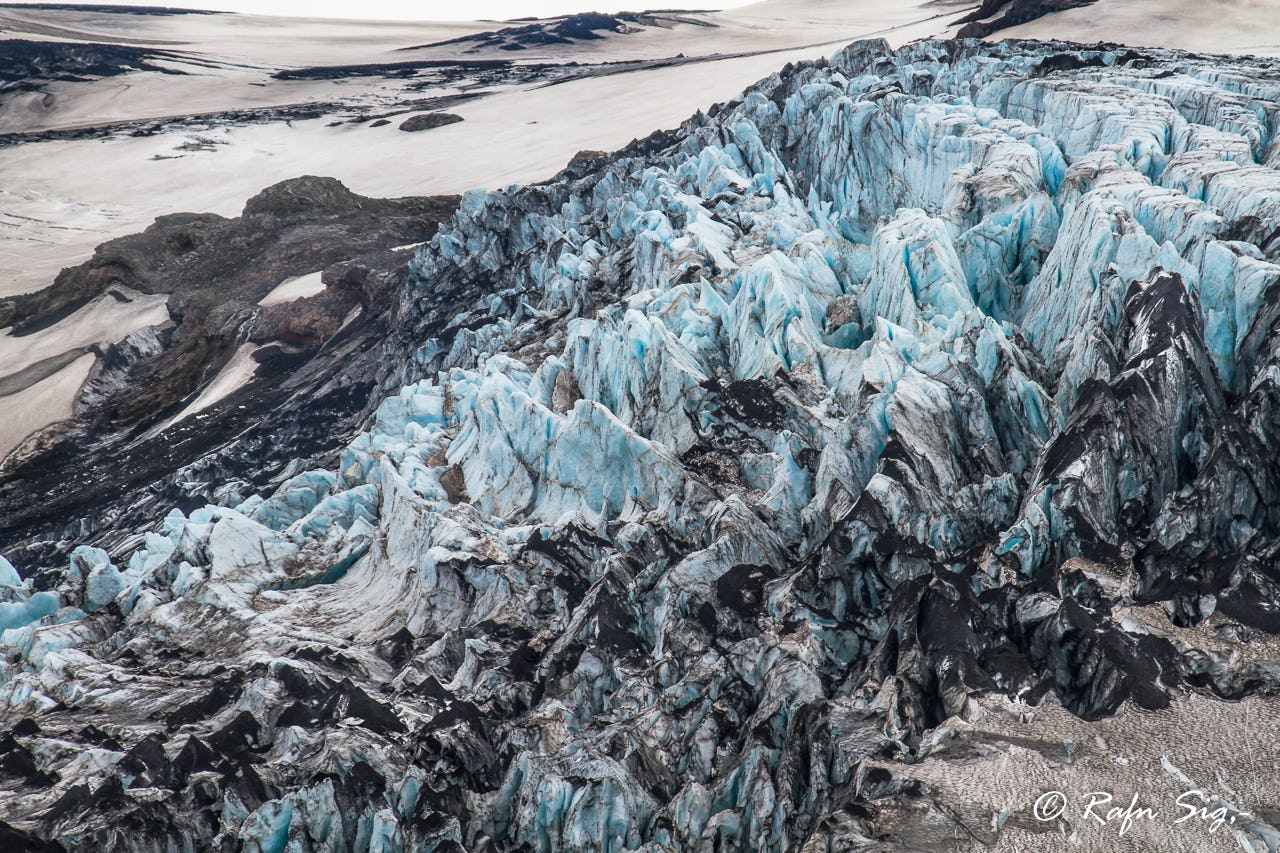 From a helicopter, the glacier appears like shards of glass piled up together.