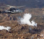 A helicopter tour allows you to circle over interesting geological features, such as steaming volcanic vents.
