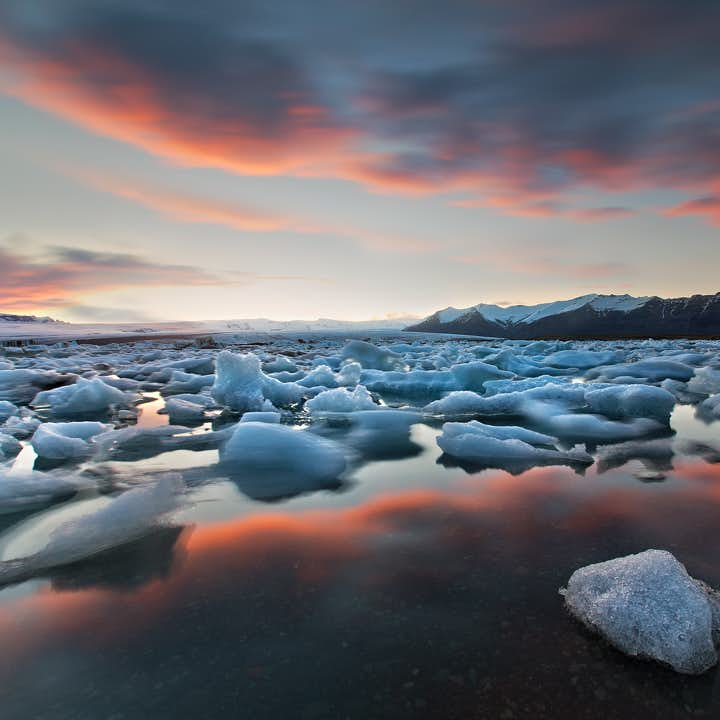 A sunset sky in summer reflecting perfectly off the jewel of Iceland's south, the Jökulsárlón Glacier Lagoon.