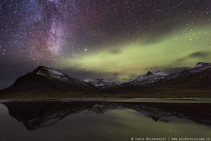 披在山峰之上的冰岛北极光