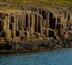 Breiðafjörður fjord is framed by stunning rock formations.