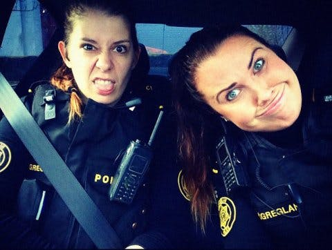Icelandic police officers pulling silly faces