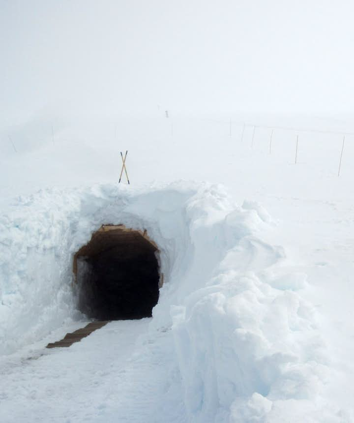 The entrance to the ice cave tunnel - Into the Glacier