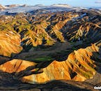The rhyolite mountains of the central Icelandic Highlands are unexampled, bathed in the glow of the summer sun.