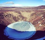 Kerið is an explosion crater lake in South Iceland, known for its distinctive red slopes.