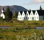 Quaint buildings amongst the greenery of Þingvellir in summer.