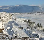 Snow covers the landscapes of Þingvellir National Park, on the Golden Circle, in winter.