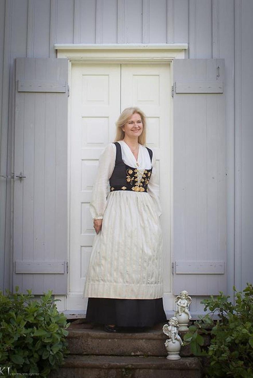 Sigrún Þormar in a national costume at Fitjakirkja church