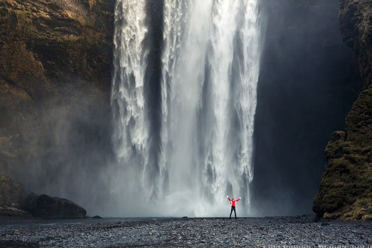Photographs of Skógafoss in winter can capture its scale and power.