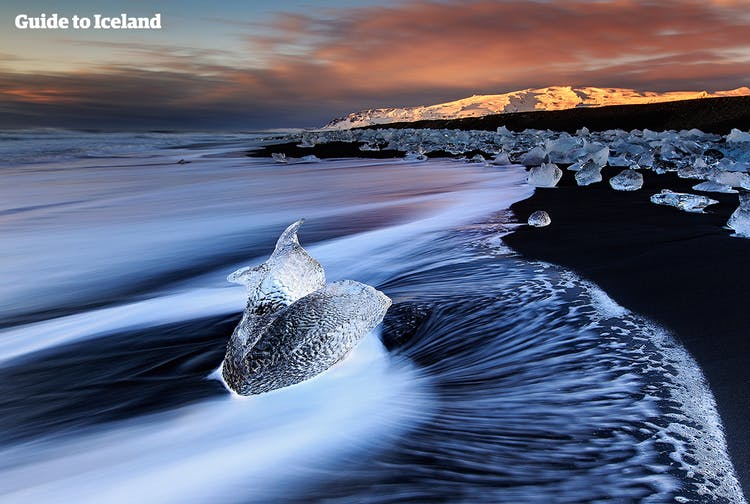 The surf playing with chunks of ice on the black sand Diamond Beach in winter.