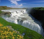 A rainbow almost always arches over Gullfoss waterfall on bright summer days.