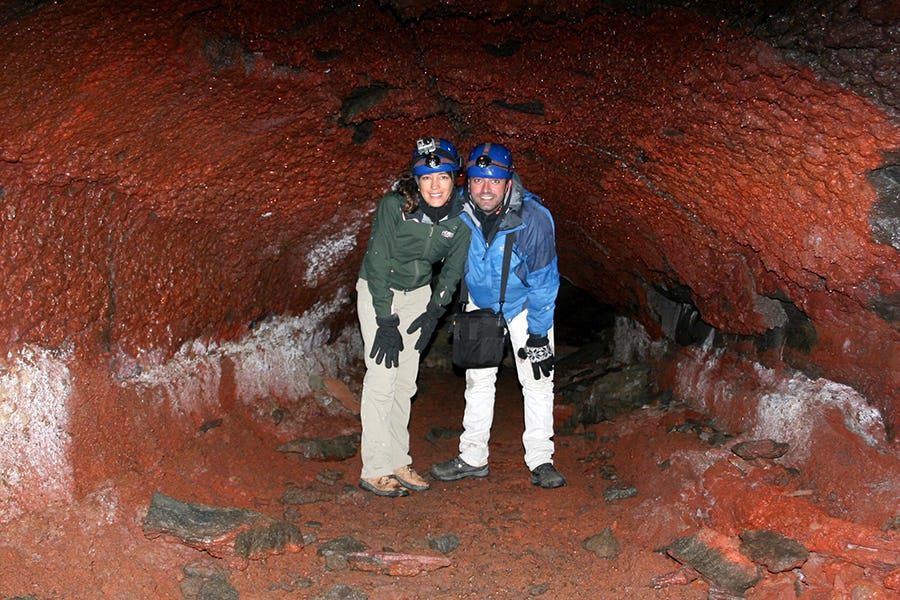 The spectacular red colouring of Iceland's lava caves will take your breath away.