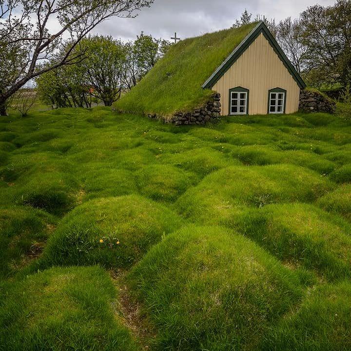 Discover Iceland hidden gems, like the turf church Hofskirkja, with a self-drive tour.