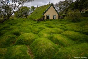 Discover Iceland hidden gems, like the turf church Hofskirkja, with a self-drive tour.