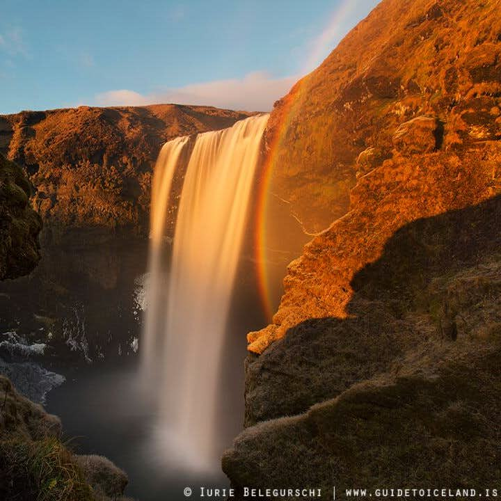 In the summer glow of the sun, a rainbow is constantly present in the mist from Skógafoss waterfall.