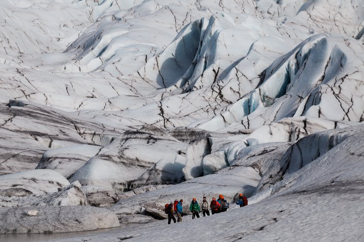 Glacier hiking is a thrilling, yet inherently dangerous activity. Make sure to always scale the ice cap with a professional and certified guide.