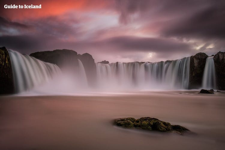 Pictured here beneath the midnight sun, all visitors should stop at Goðafoss waterfall as they follow the ring road through north Iceland.