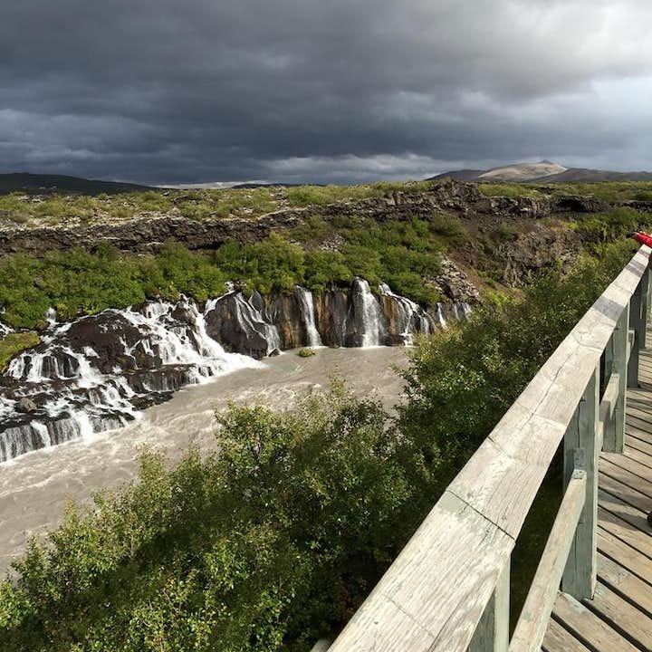 Hraunfossar is a series of 'mini-falls', where water streams through porous space in the dense lava rock.