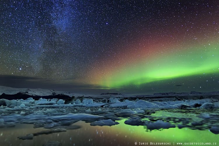 Jökulsárlón has doubled in size over a fifteen year, but is still no match for the sheer expansiveness of the Aurora above.