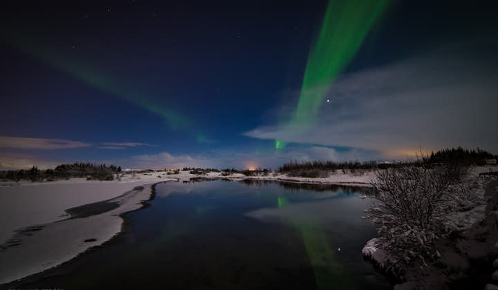 The Northern Lights can appear in the sky, even though it is not yet fully dark.
