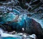 A shaft of light falls from above into one of Vatnajökull's incredible ice caves in south-east Iceland.