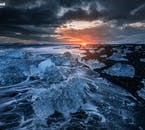 The Diamond Beach, in Iceland's south-east, is a place of contrasting colour, with blue ice, black sands, white surf and blood-red skies in winter.
