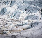 An Icelandic glacier lined with veins of black ash.