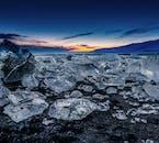 The Diamond Beach by Jökulsárlón glacier lagoon is a stunning display of ice chunks on a blanket of black velvet sand.