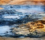 The geothermal valley Haukadalur in Iceland is dotted with bubbling mud pools in a rhyolitic landscape.