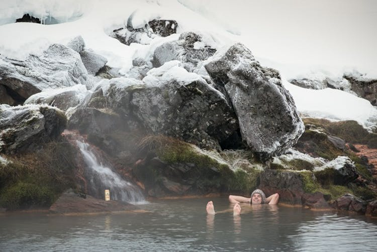 Bathing in a hot spring in Landmannalaugar in winter is a great way to stave off the chill.