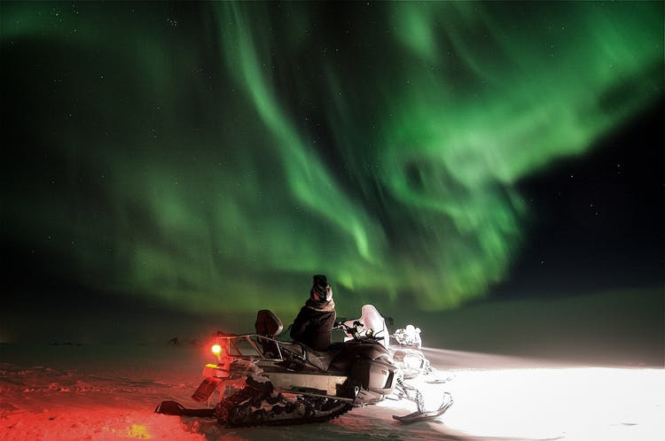 Snowmobiling and the northern lights hunting are two awesome winter opportunities that you can combine.