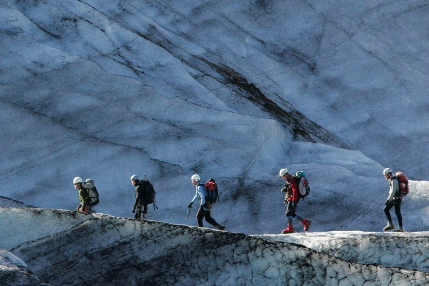 Icelandic rescue team hiking up a glacier to help a hurt skier