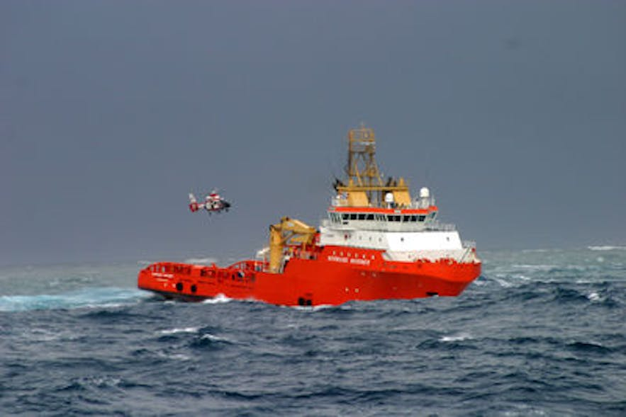 Icelandic air rescue team delivering a heart monitor to a ship