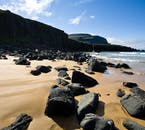 Chunks of rock litter Rauðasandur beach.