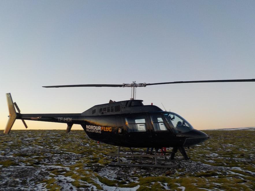 Norðurflug helicopter on mountain Esjan by Reykjavík