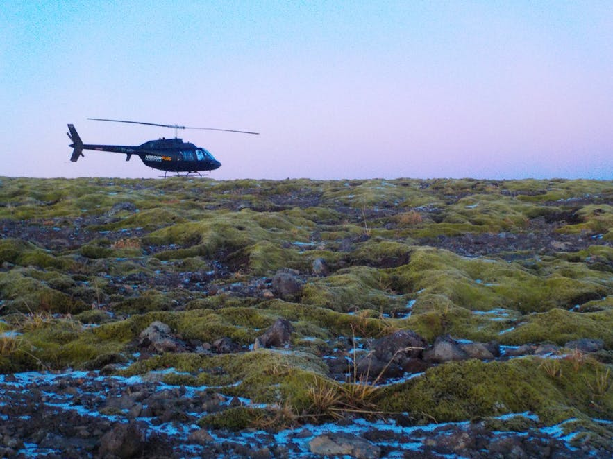 Helicopter surrounded by sunset sky on top of Mt Esjan