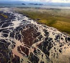 South Iceland's rivers run over courses of black sands as they make their way to the Atlantic Ocean.