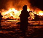 During new years in Iceland, locals gather at bonfires in every town and city district.