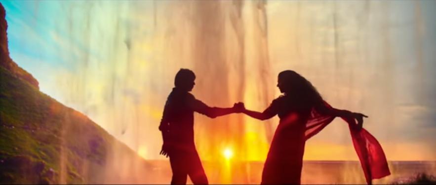 Shah Rukh Khan and Kajol behind Seljalandsfoss waterfall in Iceland