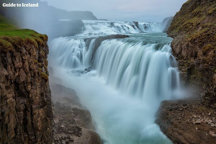 Gullfoss waterfall tumbles in two enormous tires into the deep canyon below.