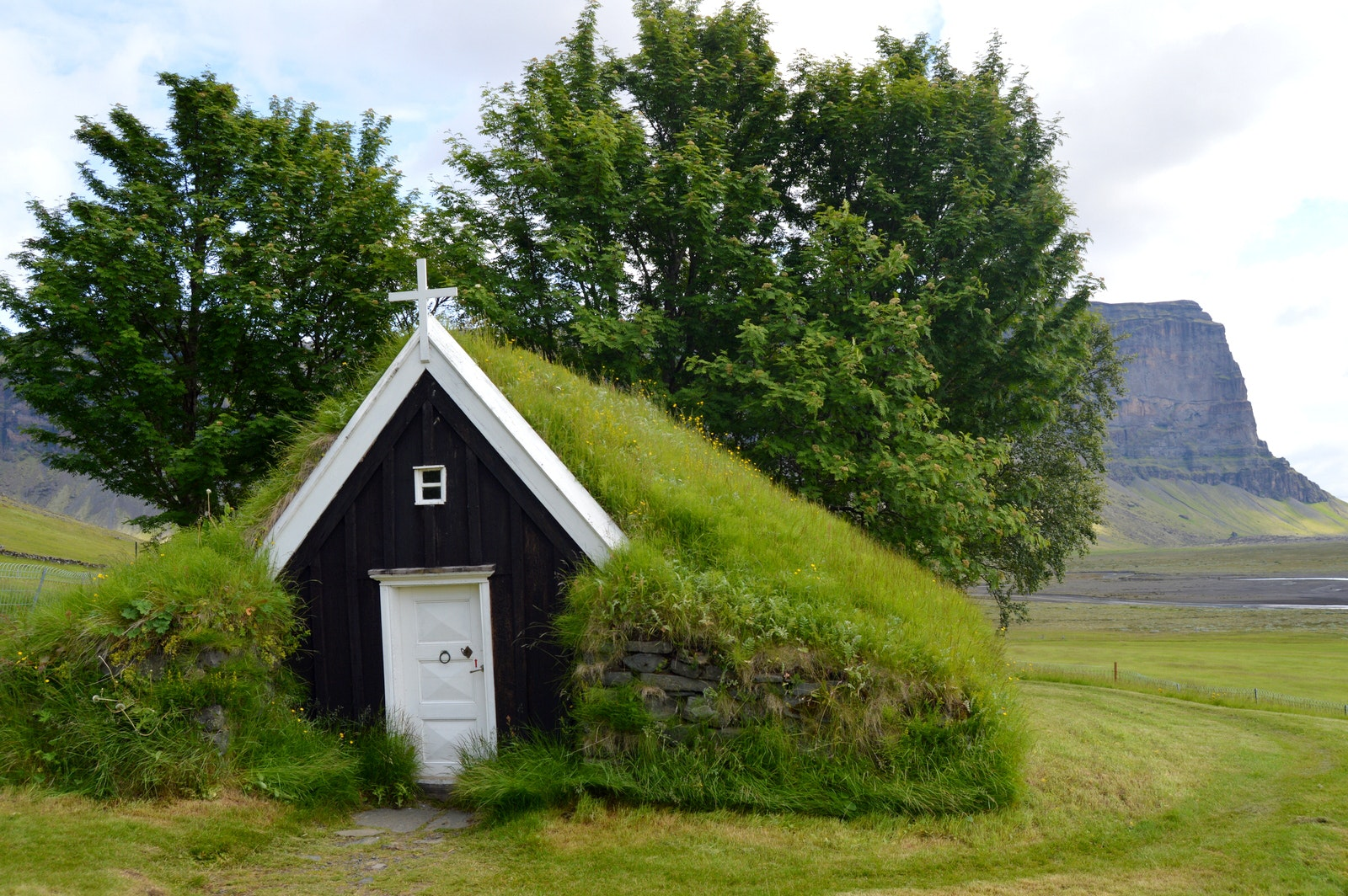 Núpsstaður Turf Church and Mt. Lómagnúpur in South-Iceland - the smallest Turf Church in Iceland