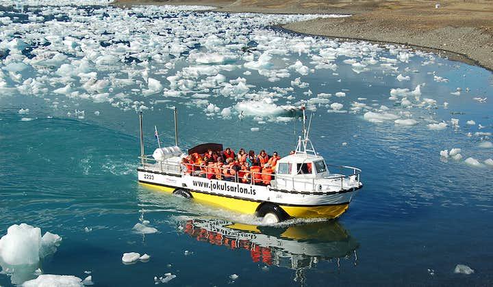 An amphibious boat cruises across the Jökulsárlón glacier lagoon.