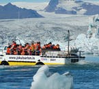 An amphibious boat approaches the glacial tongue feeding Jökulsárlón glacier lagoon.