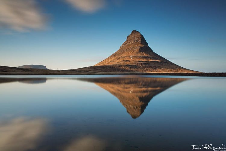 On the northern shores of the Snæfellsnes Peninsula, visitors can find Kirkjufell mountain, a popular spot for sightseers and experienced rock-climbers.