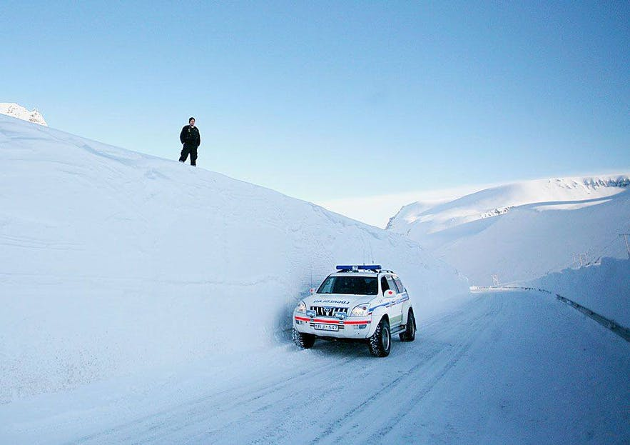 Police car driving in the Westfjords
